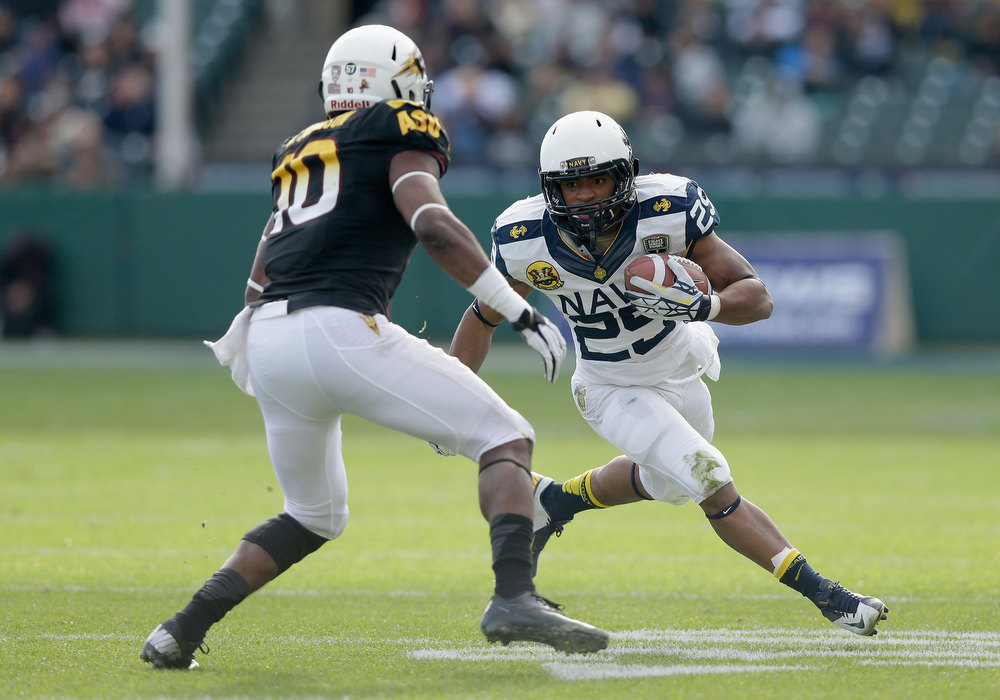 Description of . Geoffrey Whiteside #29 of the Navy Midshipmen runs with the ball during the Kraft Fight Hunger Bowl against the Arizona State Sun Devils at AT&T Park on December 29, 2012 in San Francisco, California. (Photo by Ezra Shaw/Getty Images)