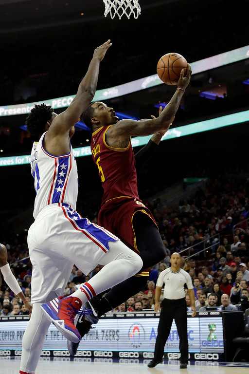 . Cleveland Cavaliers\' J.R. Smith, right, goes up for a shot against Philadelphia 76ers\' Joel Embiid during the first half of an NBA basketball game, Sunday, Nov. 27, 2016, in Philadelphia. (AP Photo/Matt Slocum)