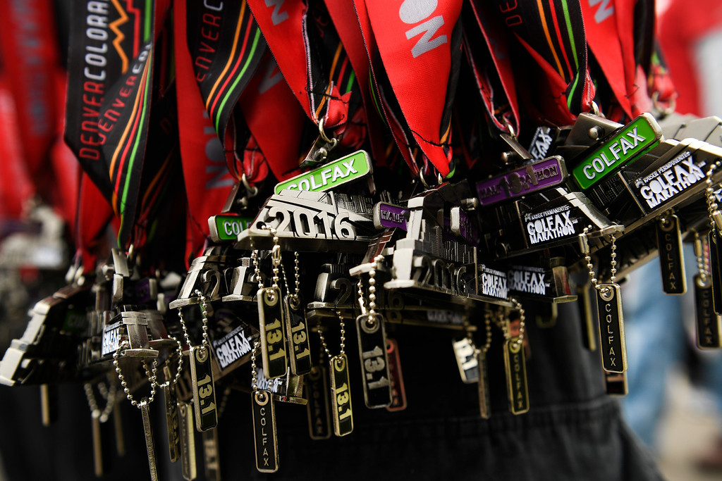. DENVER, CO - MAY 15: Firefighters with West Metro Fire Rescue helped hand out these race medals after the Colfax Marathon, Half Marathon and Urban 10 miler during the 11th annual Colfax Half Marathon on May 15, 2016 in Denver, Colorado.  Thousands of runners took part in the annual springtime race which included a marathon, a marathon relay,  a half marathon and the urban 10 miler.  (Photo by Helen H. Richardson/The Denver Post)