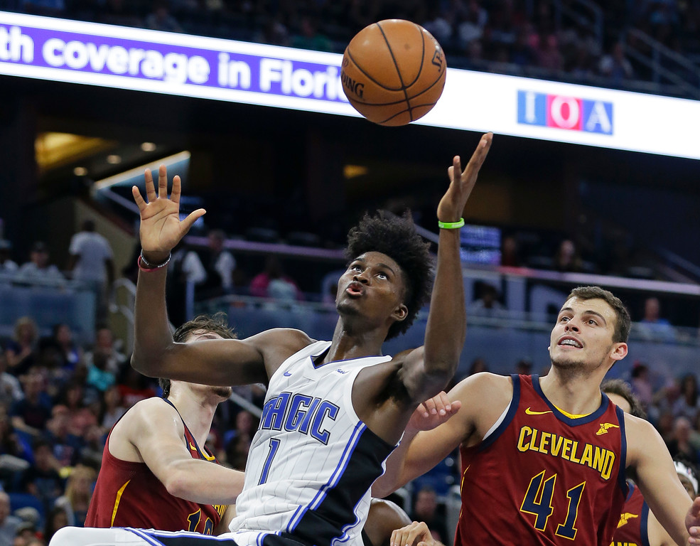 . Orlando Magic\'s Jonathan Isaac (1) goes up for a rebound in front of Cleveland Cavaliers\' Ante Zizic (41) during the second half of an NBA preseason basketball game, Friday, Oct. 13, 2017, in Orlando, Fla. (AP Photo/John Raoux)