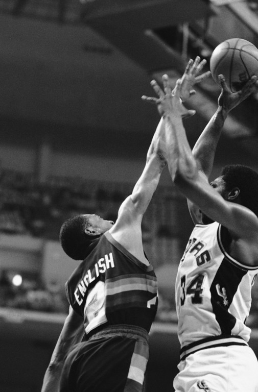 . 23. Alex English, shown at left (Associated Press file)