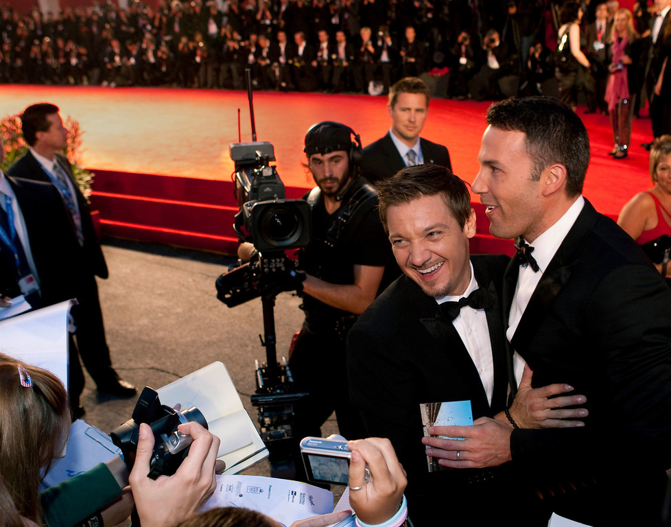 . Director Ben Affleck, right, and actor Jeremy Renner embrace prior to signing autographs as they arrive for the screening of the film The Town at the 67th edition of the Venice Film Festival in Venice, Italy, Wednesday, Sept. 8, 2010. (AP Photo/Domenico Stinellis)