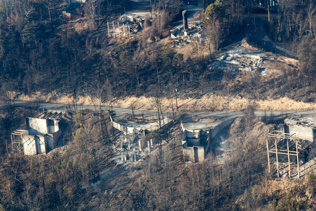 . Burned structures are seen from aboard a National Guard helicopter near Gatlinburg, Tenn., Tuesday, Nov. 29, 2016. The fires spread quickly on Monday night, when winds topping 87 mph whipped up the flames, catching residents and tourists in the Gatlinburg area by surprise. Police banged on front doors and told people to get out immediately. (AP Photo/Erik Schelzig)