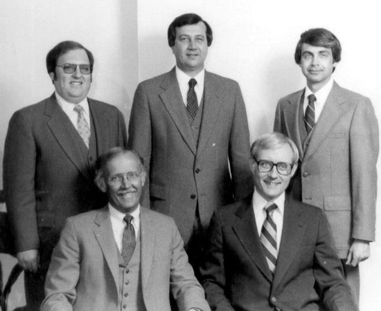 Howard's retirement dinner. In 1975 ten partners started Williams, Young & Associates.  By the early 80's five of those early partners had left and these five remained.  This photo is from about 1982.  Top row - Gary Friedman, Larry Conners, Howard Gesbeck.  Bottom Row - Bill Young, Ray Weihofen.