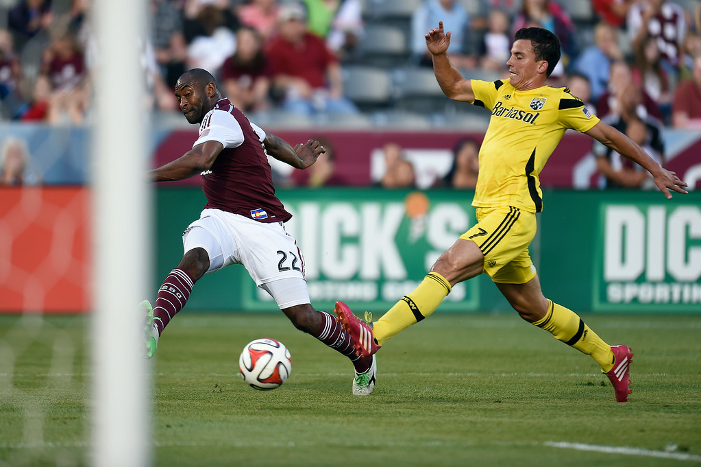 . Marvell Wynne #22 of the Colorado Rapids passes the ball while trailed by Bernardo Anor #7 of the Columbus Crew during the first half of an MLS game at Dick\'s Sporting Goods Park on July 4, 2014, in Commerce City, Colorado.  The Rapids and Crew drew 1-1. (Photo by Daniel Petty/The Denver Post)