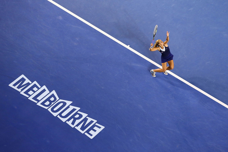 . Dominika Cibulkova of Slovakia serves in her women\'s final match against Na Li of China during day 13 of the 2014 Australian Open at Melbourne Park on January 25, 2014 in Melbourne, Australia.  (Photo by Quinn Rooney/Getty Images)
