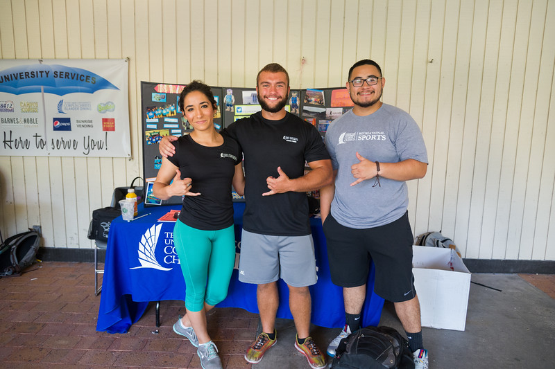Students Christine Duran, Max Caruso and Jose Sarz inform new and old Islanders about what recriational sports we have to offer here at Texas A&M Corpus Christi