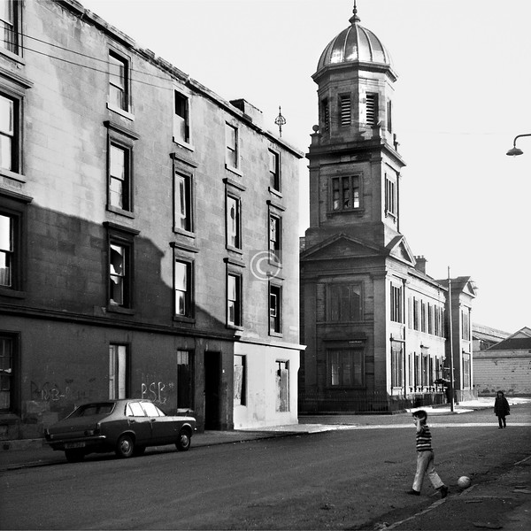 Wellpark St, north side.   The fine Italianate building, which survives along with its associated Trinity Duke St Church, was built in 1867 as the Wellpark Institute, a Free Church school (possibly financed by the nearby Wellpark Brewery), later became Wellpark School, and is now Wellpark Enterprise Centre.    June 1975