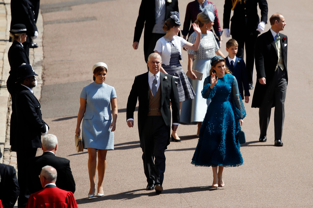 . Britain\'s Prince Andrew, center, arrives with Princess Beatrice, right, and Princess Eugenie arrive for the wedding ceremony of Prince Harry and Meghan Markle at St. George\'s Chapel in Windsor Castle in Windsor, near London, England, Saturday, May 19, 2018. (Odd Anderson/pool photo via AP)