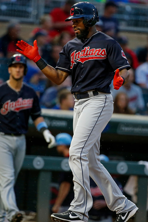 . Cleveland Indians center fielder Austin Jackson celebrates his solo home run against the Minnesota Twins in the fourth inning of the second baseball game of a doubleheader Saturday, June 17, 2017, in Minneapolis. (AP Photo/Bruce Kluckhohn)