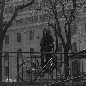 Stature of Eminescu (rear view) from Rue de Jean Beauvais, Paris, with bicycle and stair railings