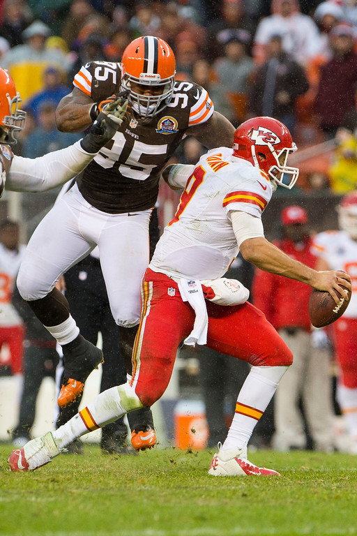 . CLEVELAND, OH - DECEMBER 09: Defensive end Juqua Parker #95 of the Cleveland Browns sacks quarterback Brady Quinn #9 of the Kansas City Chiefs during the second half at Cleveland Browns Stadium on December 9, 2012 in Cleveland, Ohio. The Browns defeated the Chiefs 30-7. (Photo by Jason Miller/Getty Images)