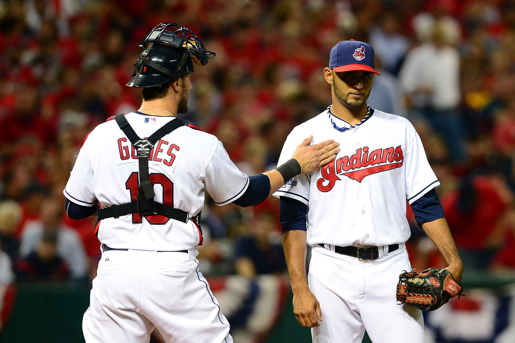 . CLEVELAND, OH - OCTOBER 02:  Yan Gomes #10 of the Cleveland Indians talks with teammate Danny Salazar #31 in the fourth inning against the Tampa Bay Rays during the American League Wild Card game at Progressive Field on October 2, 2013 in Cleveland, Ohio.  (Photo by Jason Miller/Getty Images)