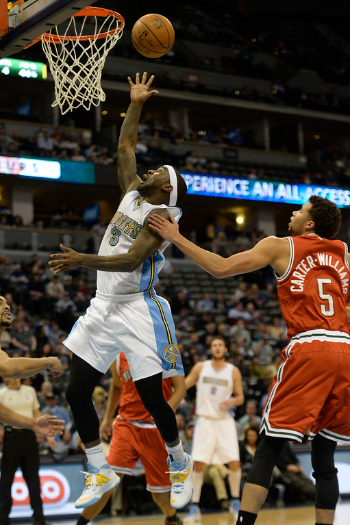. DENVER, CO - MARCH 03: Ty Lawson (3) of the Denver Nuggets lays the ball up as Michael Carter-Williams (5) of the Milwaukee Bucks defends during the second quarter of action. The Denver Nuggets hosted the Milwaukee Bucks at the Pepsi Center on Tuesday, March 3, 2015. (Photo by AAron Ontiveroz/The Denver Post)
