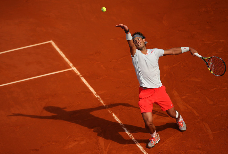 . Rafael Nadal of Spain serves in his Men\'s Singles match against Kei Nishikori of Japan during day nine of the French Open at Roland Garros on June 3, 2013 in Paris, France.  (Photo by Julian Finney/Getty Images)
