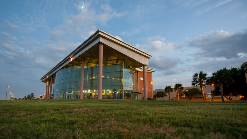 The Performing Arts Center looks grand in the evening light on campus