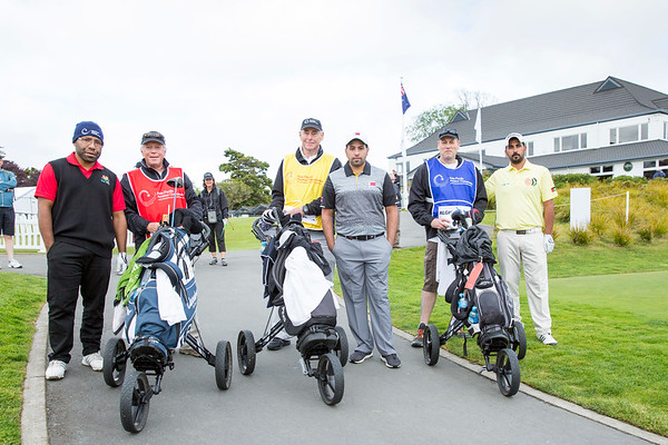 Gideon Tikili from Papua New Guinea, Abdulrahman Al Shahrani from Qatar and Tariq Alghababshen from Jordan together with their caddies after hitting off the 1st tee on Day 1 of competition in the Asia-Pacific Amateur Championship tournament 2017 held at Royal Wellington Golf Club, in Heretaunga, Upper Hutt, New Zealand from 26 - 29 October 2017. Copyright John Mathews 2017.   www.megasportmedia.co.nz