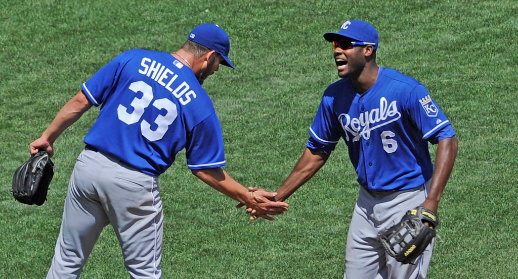 . Royals starter James Shields congratulates center fielder Lorenzo Cain on a catch Cain made that robbed Minnesota\'s Trevor Plouffe of a home run during the fifth inning. (Photo by Hannah Foslien/Getty Images)
