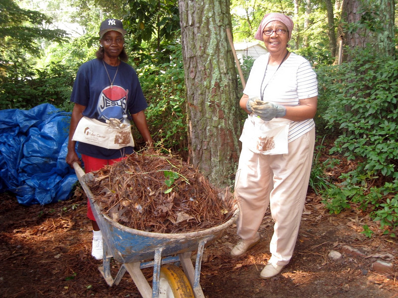 Lillie Miller (right) and her niece Patricia helping to clean yard around the house.  ky  lcf