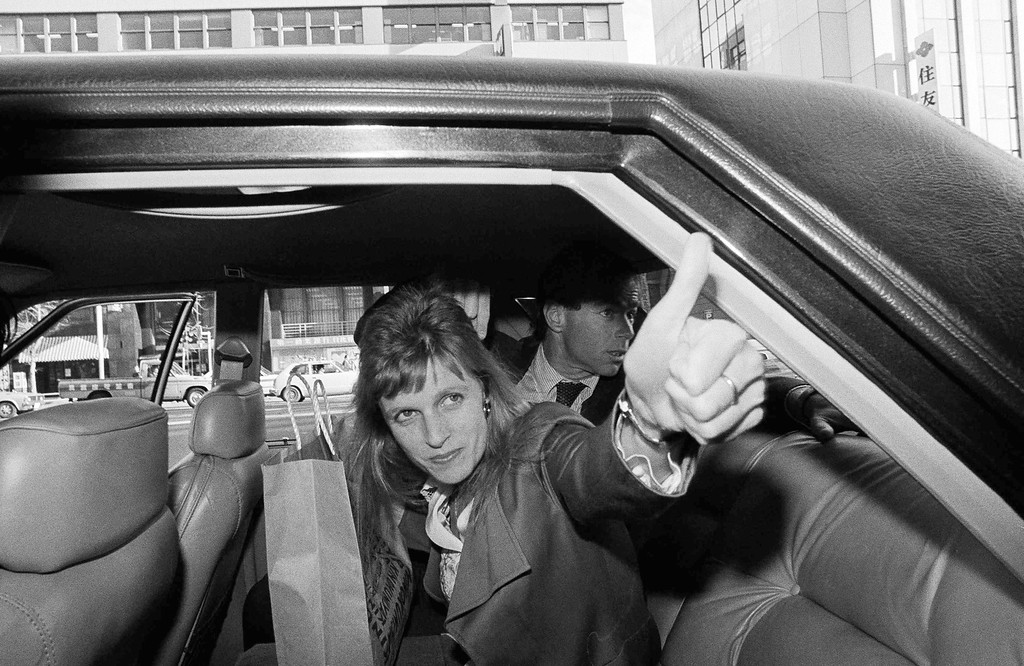 . Linda McCartney, wife of jailed former Beatle Paul McCartney, gives the thumbs up sign after visiting husband at the Tokyo Metropolitan Police Headquarters, Jan. 24, 1980.  McCartney began his second week in jail as authorities continued their investigation into his alleged possession of marijuana. (AP Photo/Katsumi Kasahara)