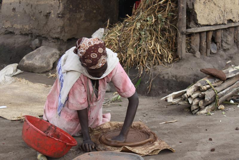 Ari woman making clay dish
