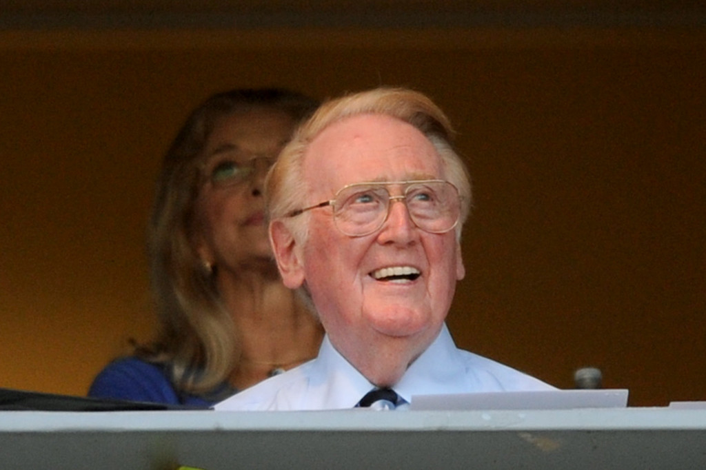 . Dodgers announcer Vin Scully confirmed he will return for the 2014 season before the Dodgers-Red Sox game. Friday, August 23, 2013. (Michael Owen Baker/L.A. Daily News)