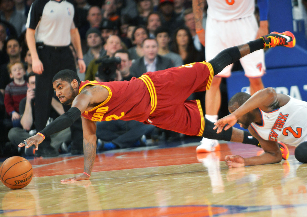 . Cleveland Cavaliers\' Kyrie Irving dives for a loose ball during the second quarter of an NBA basketball game against the New York Knicks Thursday, Jan. 30, 2014, at Madison Square Garden in New York. The Knicks won 117-86. (AP Photo/Bill Kostroun)