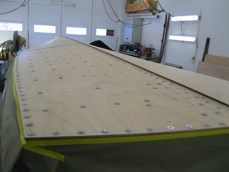 Rear starboard view of first layer of bottom installed and held in place with tempory fasteners.