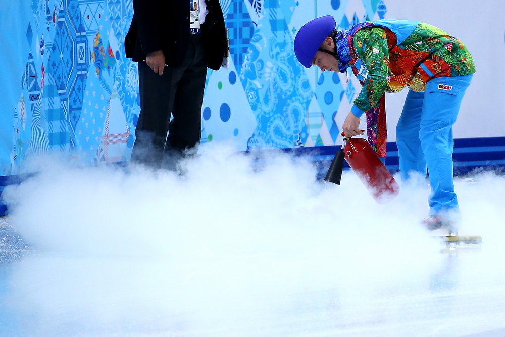 . A volunteer resurfaces the rink during the Short Track Men\'s 500m Heat at Iceberg Skating Palace on day 11 of the 2014 Sochi Winter Olympics on February 18, 2014 in Sochi, Russia.  (Photo by Streeter Lecka/Getty Images)
