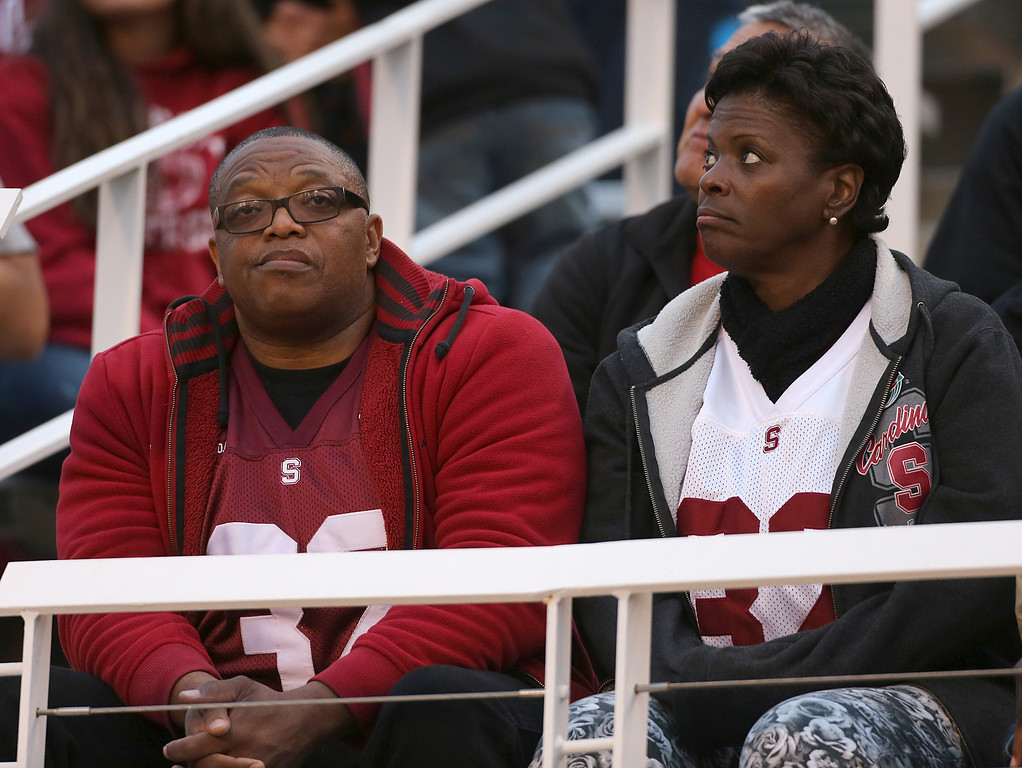 . SALT LAKE CITY, UT - OCTOBER 12: Two fans of the Stanford Cardinal watch the field and glance at the scoreboard late in the fourth quarter during a game against the Utah Utes at an NCAA football game October 12, 2013 at Rice Eccles Stadium in Salt Lake City, Utah. Utah Beat Stanford 27-21. (Photo by George Frey/Getty Images)