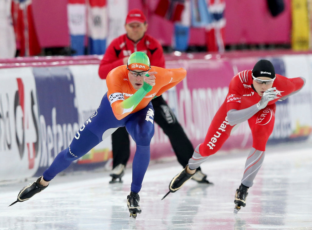 Description of . Sven Kramer of the Netherlands (L) skates next to Havard Bokko of Norway in the men's 1500m distance event at the World Speedskating Championships in Hamar in this picture provided by NTB Scanpix February 17, 2013. REUTERS/Hakon Mosvold Larsen/NTB Scanpix
