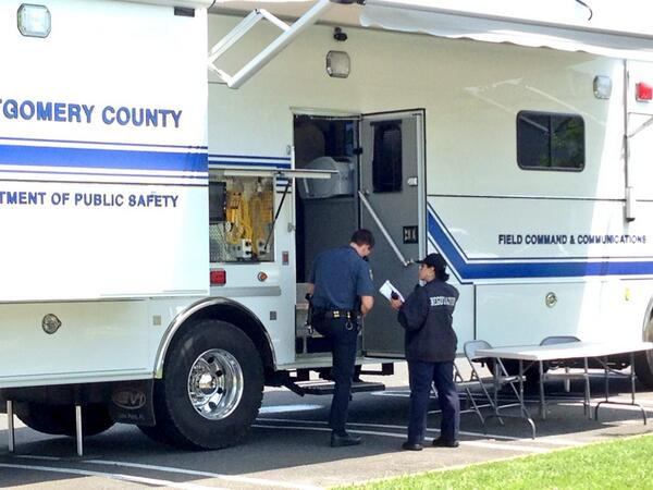 . Montgomery Township Police Chief Bendig talks with apolice negotiator outside the county command center near the scene of a shooting Monday, June 2, 2014. (Photo by Michael Alan Goldberg/The Reporter)