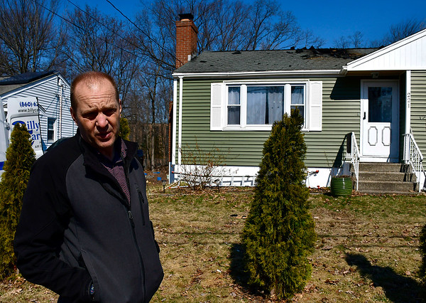 3/20/2019 Mike Orazzi | Staff Jim Elsner tallks about fire damage at his home on Beths Avenue in Bristol after a fire late Tuesday night that left the home uninhabitable.