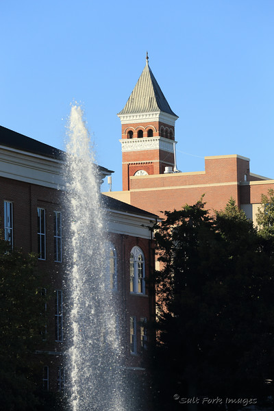 Fountains in the Cooper Library reflecting pool and Tillman Hall's clock tower.  Clemson University