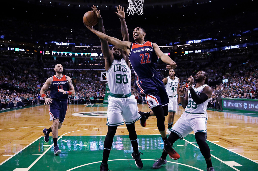 . Washington Wizards forward Otto Porter Jr. (22) drives to the basket between Boston Celtics forwards Amir Johnson (90) and Jae Crowder (99) during the first quarter of a second-round NBA playoff series basketball game in Boston, Tuesday, May 2, 2017. (AP Photo/Charles Krupa)