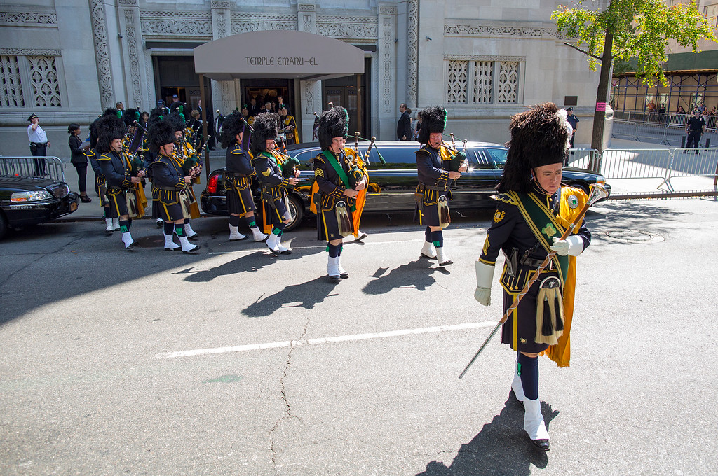 . Bagpipers march out the doors of Temple Emanu-El onto Fifth Avenue after the funeral service for comedian Joan Rivers in New York Sunday, Sept. 7, 2014. Rivers died Thursday at 81. (AP Photo/Craig Ruttle)