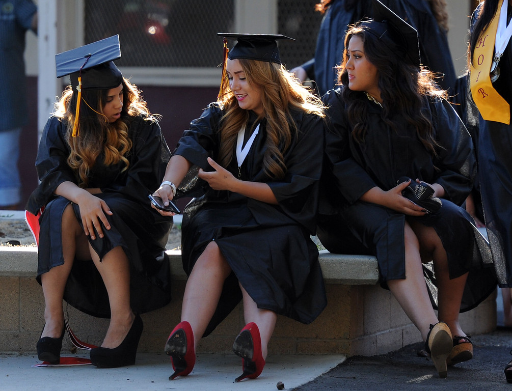 . Students prepare prior to the Vail High School commencement at Vail High School on Tuesday, June 18, 2013 in Montebello, Calif.