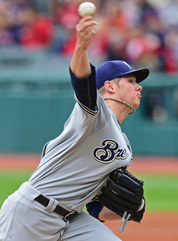 . Milwaukee Brewers starting pitcher Chase Anderson delivers in the first inning of a baseball game against the Cleveland Indians, Wednesday, June 6, 2018, in Cleveland. (AP Photo/David Dermer)
