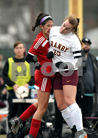 11/18/2017 Mike Orazzi | Staff Granby Memorial's Mackenzie Stahl (25) and Berlin's Lea Cabral (7) during the Class M Final at Municipal Stadium in Waterbury Saturday. Granby won 3-0.