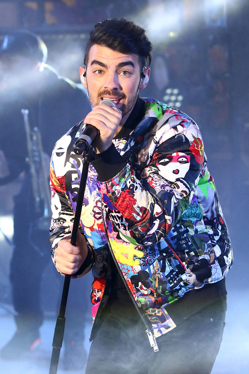 . Joe Jonas of DNCE performs at the New Year\'s Eve celebration in Times Square on Saturday, Dec. 31, 2016, in New York. (Photo by Greg Allen/Invision/AP)