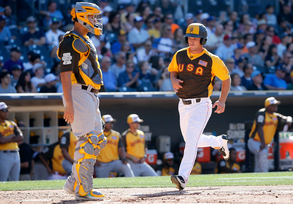 . U.S. Team\'s Alex Bregman, of the Houston Astros, right, scores on an RBI-base hit by Clint Frazier, of the Cleveland Indians, during the third inning of the All-Star Futures baseball game against the World Team, Sunday, July 10, 2016, in San Diego. (AP Photo/Lenny Ignelzi)
