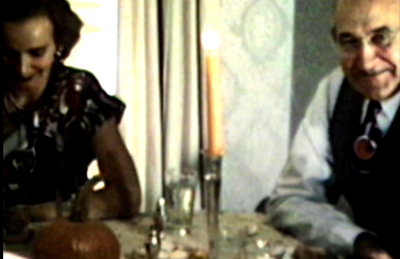 1948 Sioux City , IA Jane and her dad, Baa, at Thanksgiving dinner in Sioux Apartments. Mark & Cheryl Miller still have the silver candlesticks shown in this image.