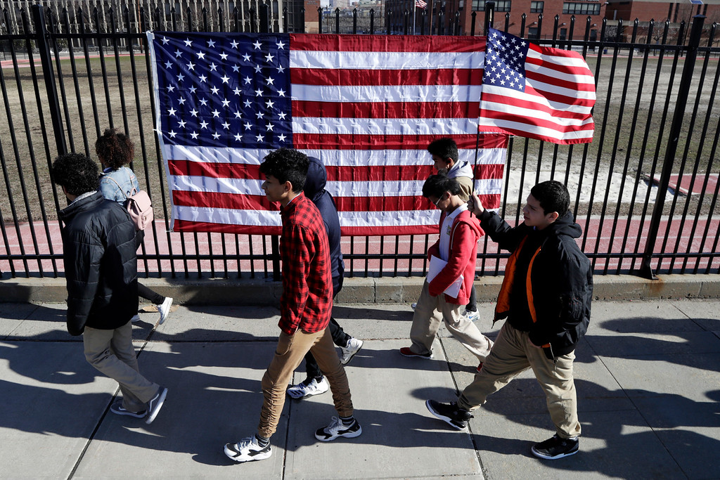 . Students from James Ferris High School march outside of the school during a student walkout, Wednesday, March 14, 2018, in Jersey City, N.J. Students across the country participated in walkouts Wednesday to protest gun violence, one month after the deadly shooting inside a high school in Parkland, Fla. (AP Photo/Julio Cortez)