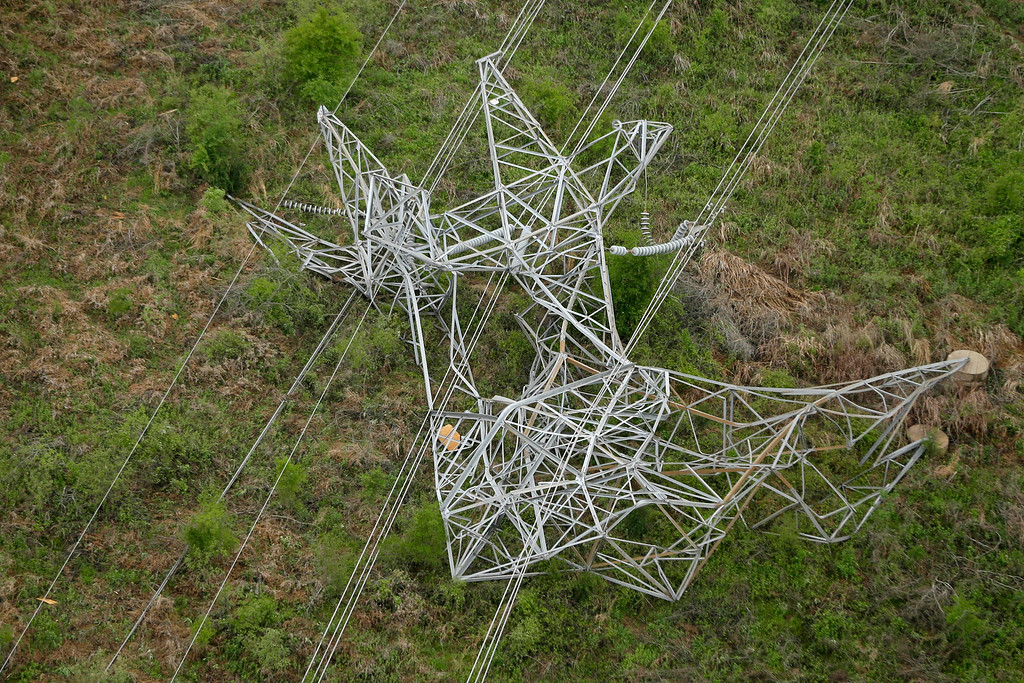 . A twisted power distribution line tower is crumpled on the ground near Mayflower, Ark., Monday, April 28, 2014 after a tornado struck the town late Sunday.   (AP Photo/Danny Johnston)