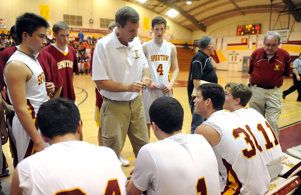 . La Canada head coach Tom Hofman during a time-out in the second half as they defeated La Salle 73-62 for coach Hofman\'s 600th win during a prep basketball game at La Canada High School in La Canada, Calif., on Friday, Jan. 10, 2014. Hofman record is 600 wins and 186 losses since becoming varsity head coach in the 1986-87 season. (Keith Birmingham Pasadena Star-News)