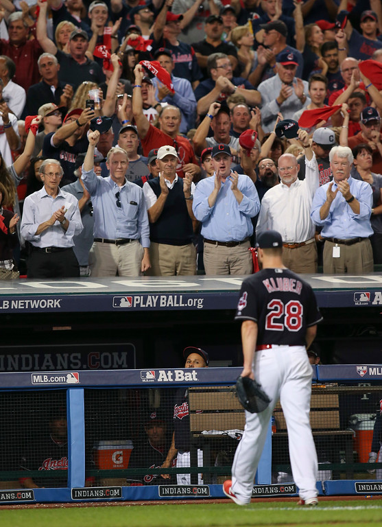 . Cleveland Indians fans cheer for pitcher Corey Kluber as he walks to the dugout in the eighth inning during Game 2 of baseball\'s American League Division Series against the Boston Red Sox, Friday, Oct. 7, 2016, in Cleveland. (AP Photo/Aaron Josefczyk)