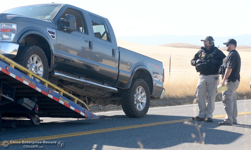 . A pickup that was involved in the shooting is towed along Rancho Tehama Road where law enforcement has the road blocked following several shootings in the Rancho Tehama community Tues. Nov. 14, 2017.  (Bill Husa -- Enterprise-Record)