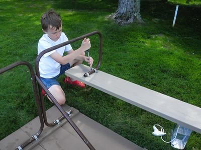 Assembling the picnic table.