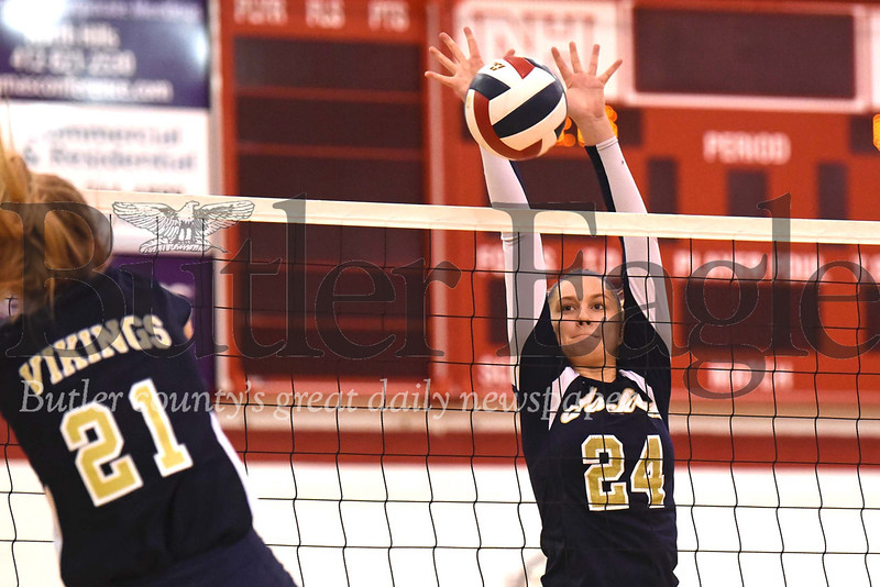 Freeport's Isabella Russo blocks a spike attempt by Hopewell's Leah Driscoll. Seb Foltz/Butler Eagle