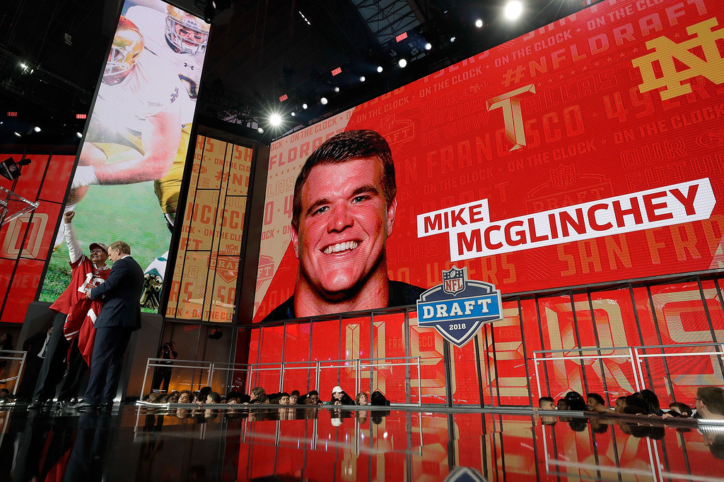 . A fan poses with a team jersey and Commissioner Roger Goodell after Notre Dame\'s Mike McGlinchey was selected by the San Francisco 49ers during the first round of the NFL football draft, Thursday, April 26, 2018, in Arlington, Texas. (AP Photo/David J. Phillip)